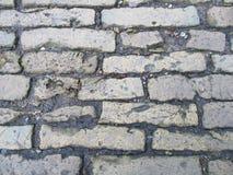 Calle vieja de pequeños ladrillos imagenes de archivo