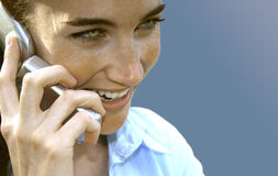Caller id. A young woman on the phone royalty free stock images