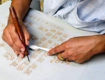 Calligrafia cinese nell'azione Fotografie Stock