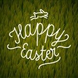 Calligrafia felice di Pasqua etichetta d'annata sul fondo dell'erba Fotografia Stock
