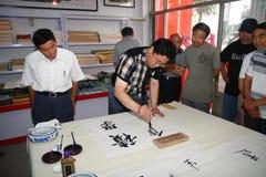 Calligrapher to create Royalty Free Stock Photos