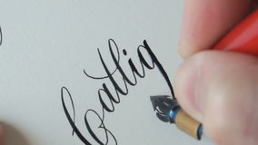 Calligrapher writing a word stock footage
