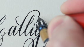Calligrapher writing a word stock video footage