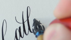 Calligrapher writing a word