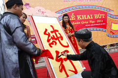 Calligraphers writing art letters for visitors in temple Stock Images