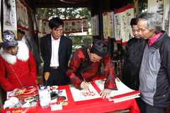 Calligraphers writing art letters for visitors in temple Royalty Free Stock Image
