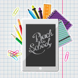 Calligraphic Back to school illustration with set of stationery and computer tablet on a exercise book sheet Royalty Free Stock Image
