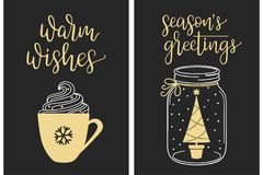 Calligraphic Christmas greetings. Christmas cards with modern calligraphy writing. Warm wishes and Seasons greetings lettering with cream coffee cup and Stock Photos