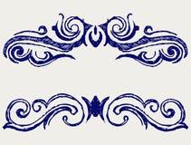 Calligraphic design element. Doodle style Stock Photos