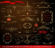 Calligraphic design elements gold on black Royalty Free Stock Images