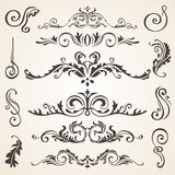 Calligraphic design elements and page decoration. Vector set to embellish your layout Stock Images