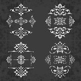 Calligraphic design elements in vintage style on a chalkboard background - vector set Royalty Free Stock Photography