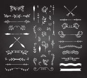 Calligraphic design elements. White on black background Royalty Free Stock Photos