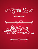 Calligraphic elements with hearts isolated on red background Royalty Free Stock Images