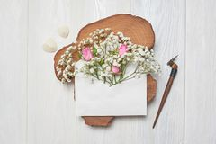 Calligraphic feather an envelope with flowers and a letter, greeting card for Valentines Day with place for your text. Flat lay, top view photo mock up Royalty Free Stock Photos