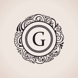 Calligraphic floral baroque monogram. Emblem letter G Royalty Free Stock Image