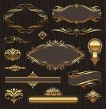 calligraphic guld- designelementramar Arkivbild