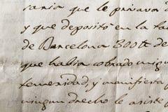 Calligraphic handstil på ett forntida dokument Arkivfoton