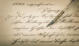 Calligraphic handwritten text and vintage ink pen. Old letter with calligraphic handwritten text and vintage ink pen. Retro style background with vignette royalty free stock photos