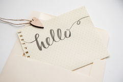 Calligraphic inscription hello and heart for greating card Stock Photos