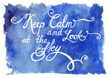Calligraphic lettering on a blue watercolor Stock Images