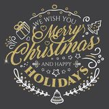 Calligraphic lettering for Merry Christmas and Happy New Year with golden glitter effect on dark background Royalty Free Stock Images