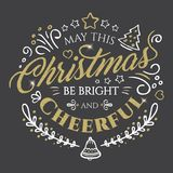 Calligraphic lettering for Merry Christmas and Happy New Year with golden glitter effect on dark background Stock Photos