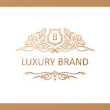Calligraphic Luxury logo. Emblem elegant decor elements. Vintage Royalty Free Stock Photography