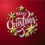 Calligraphic `Merry Christmas` Lettering Decorated with Gold Stars. Stock Photo