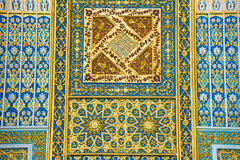 Calligraphic patterns Minor mosque in Tashkent, Uzbekistan. Beautiful white calligraphic patterns Minor mosque in Tashkent, Uzbekistan Stock Photo