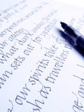 Calligraphic Pen And Handwriting On Paper Stock Photo