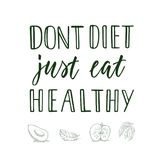 Don`t diet just eat healthy! Calligraphic quote and veggi/fruit on background. Stock Photography