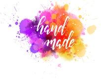 Calligraphie fabriquée à la main sur l'éclaboussure de peinture d'aquarelle Images libres de droits