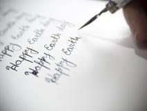 Calligraphie heureuse de jour de terre et lattering Photo stock