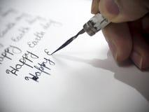 Calligraphie heureuse de jour de terre et lattering Images stock