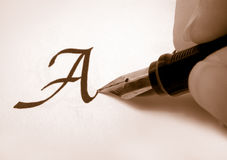 Calligraphy 2. Calligraphy pen and writing in sepia royalty free stock images