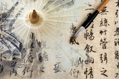 Calligraphy background and chinese paper umbrella Stock Photography