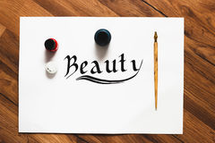 Calligraphy Beauty word background Stock Photography
