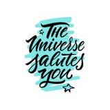 calligraphy bokstäver Uttryck: ` Universumet saluterar dig `, Royaltyfri Bild