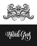 Calligraphy brush lettering text design element and carnival mas Stock Photo