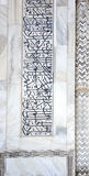 Calligraphy details of Taj Mahal architecture on white marble background Royalty Free Stock Photography