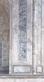 Calligraphy details of Taj Mahal architecture on white marble background Royalty Free Stock Images