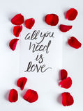 Calligraphy floral pattern top view all you need is love Stock Photos