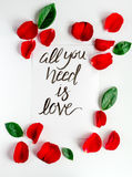 Calligraphy floral pattern top view all you need is love Stock Photo