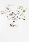 Calligraphy floral pattern top view all you need is love Stock Photography