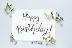 Calligraphy floral pattern top view mock up - Happy Birthday. Concept calligraphy and floral pattern top view mock up - Happy Birthday Royalty Free Stock Image