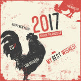 Calligraphy greeting card red fire rooster. Christmas and New Year lettering calligraphy greeting card with 2017 year of the red fire rooster. Vector Stock Images
