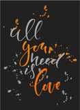 Calligraphy inscription All you need is love with splatters. Black and orange. Calligraphy inscription All you need is love Stock Photography