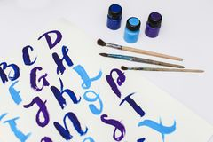 Calligraphy lettering alphabet drawn with dry brush. Letters of English ABC written with paint brush. Concept hobby or education stock images