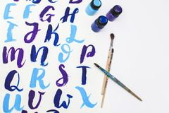 Calligraphy lettering alphabet drawn with dry brush. Letters of English ABC written with paint brush royalty free stock photography